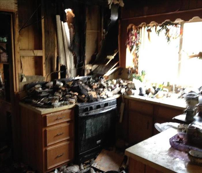 Kitchen with charred debris on the stove