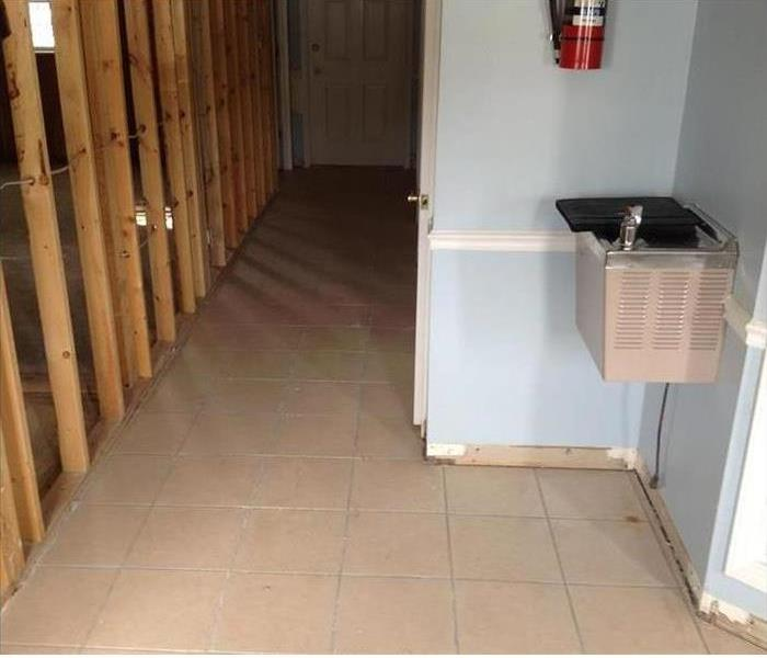 Clean tile floor with the wall framework showing