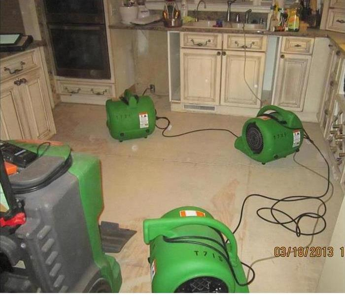 drying equipment in a water damaged kitchen
