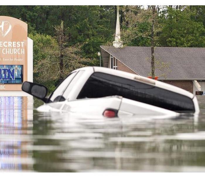 A truck is submerged in water after Hurricane Imelda